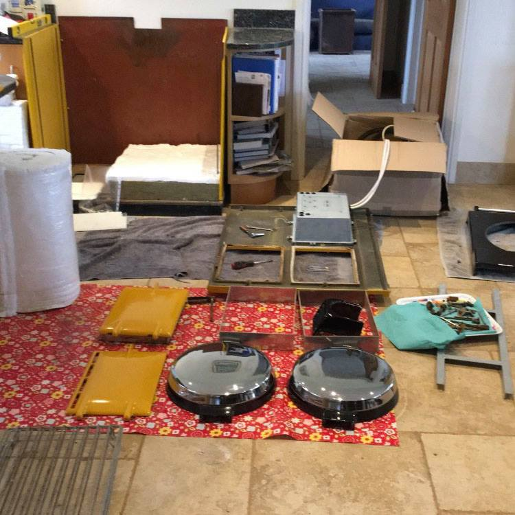 Aga range cooker parts laid out on floor