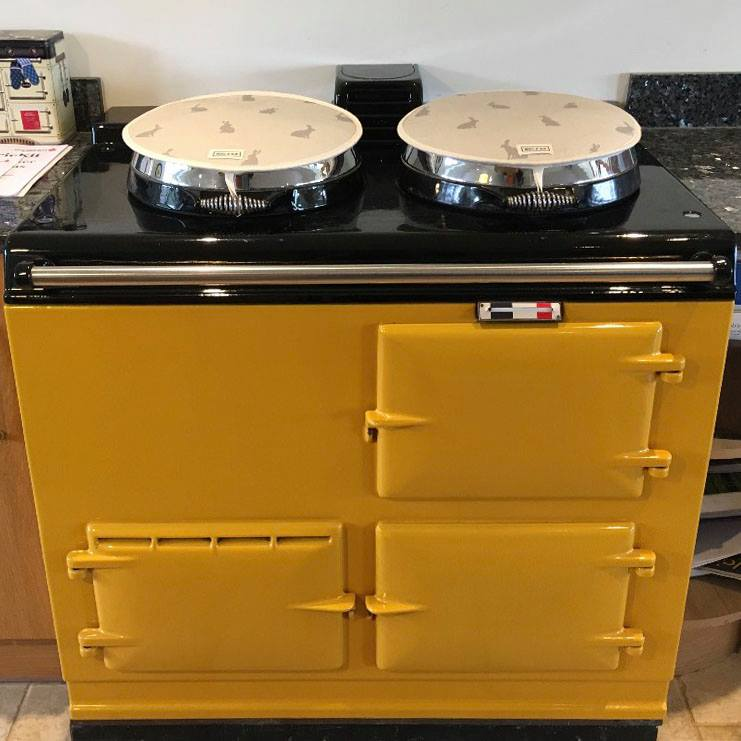 Golden yellow electric converted Aga range cooker