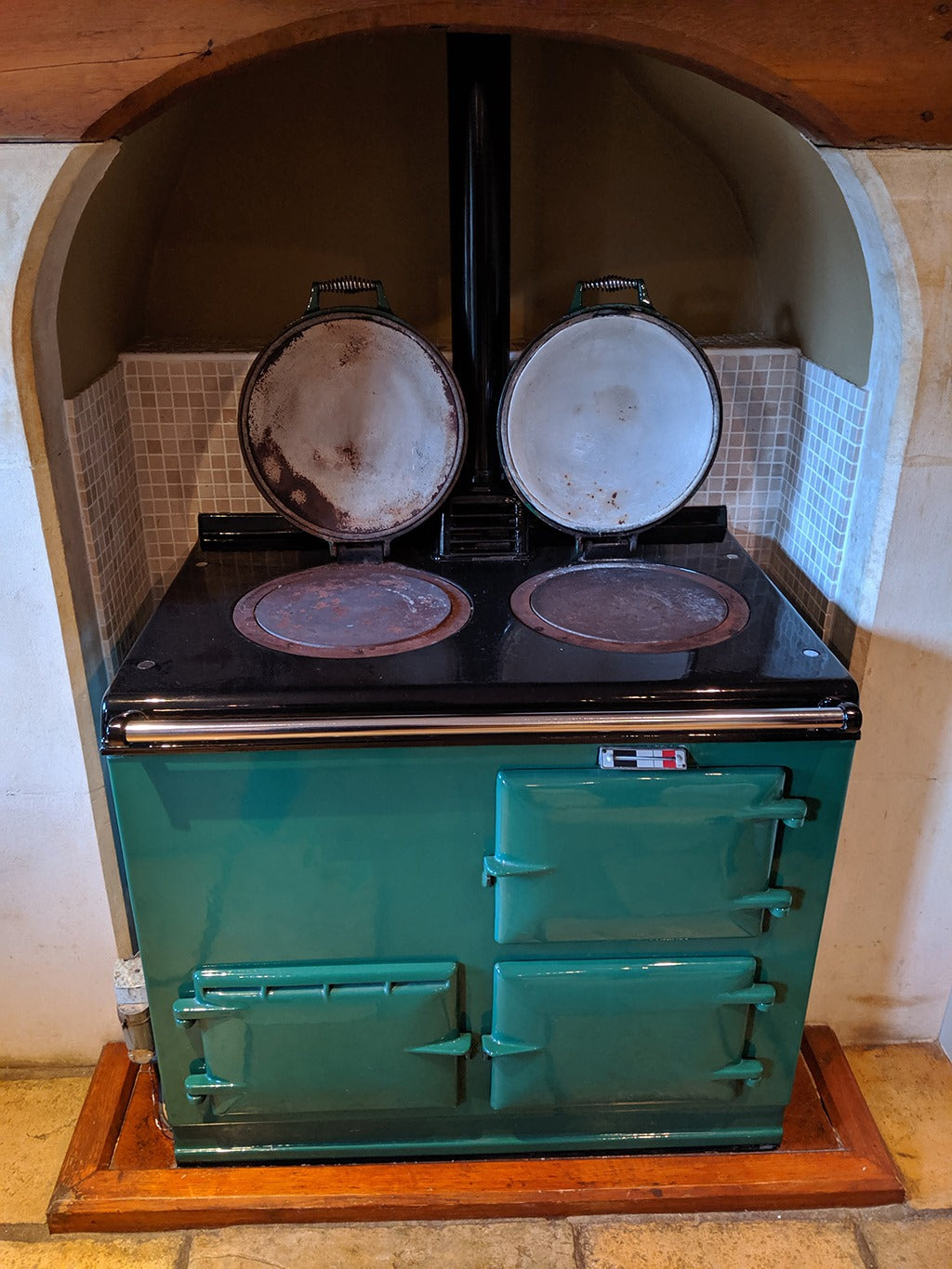Green 2 oven Aga range cooker with lids up
