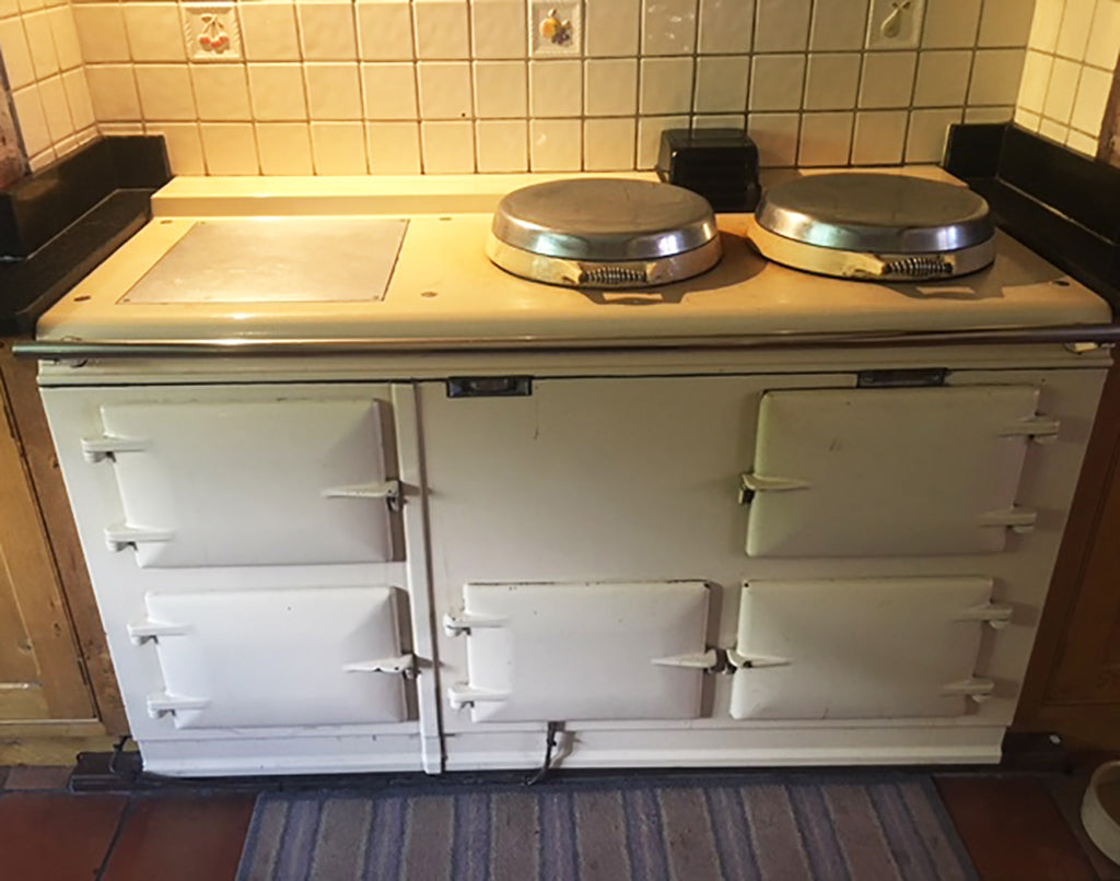 A standard Aga range cooker in cream converted to electric and re-enamelled in Saxon Blue