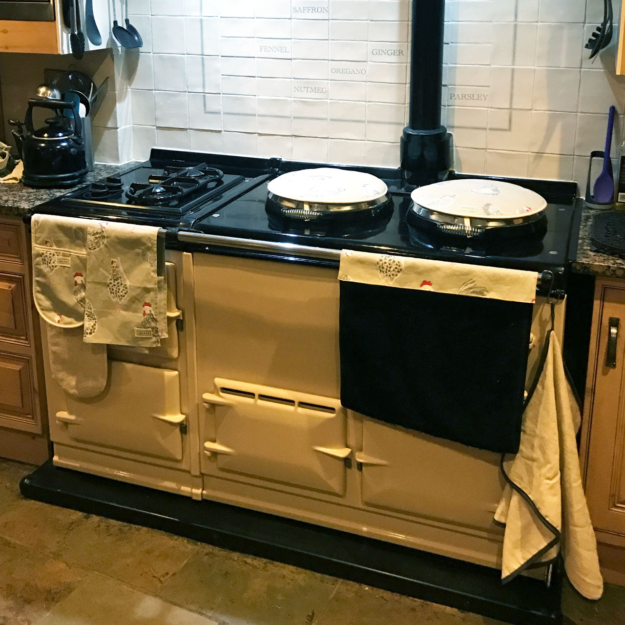 Chicken hob cover textiles on cream Aga range cooker