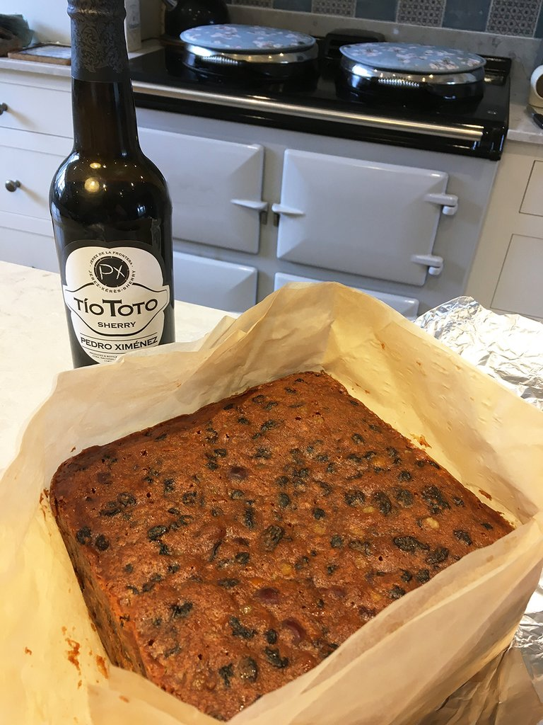 Christmas cake in front of an Aga range cooker