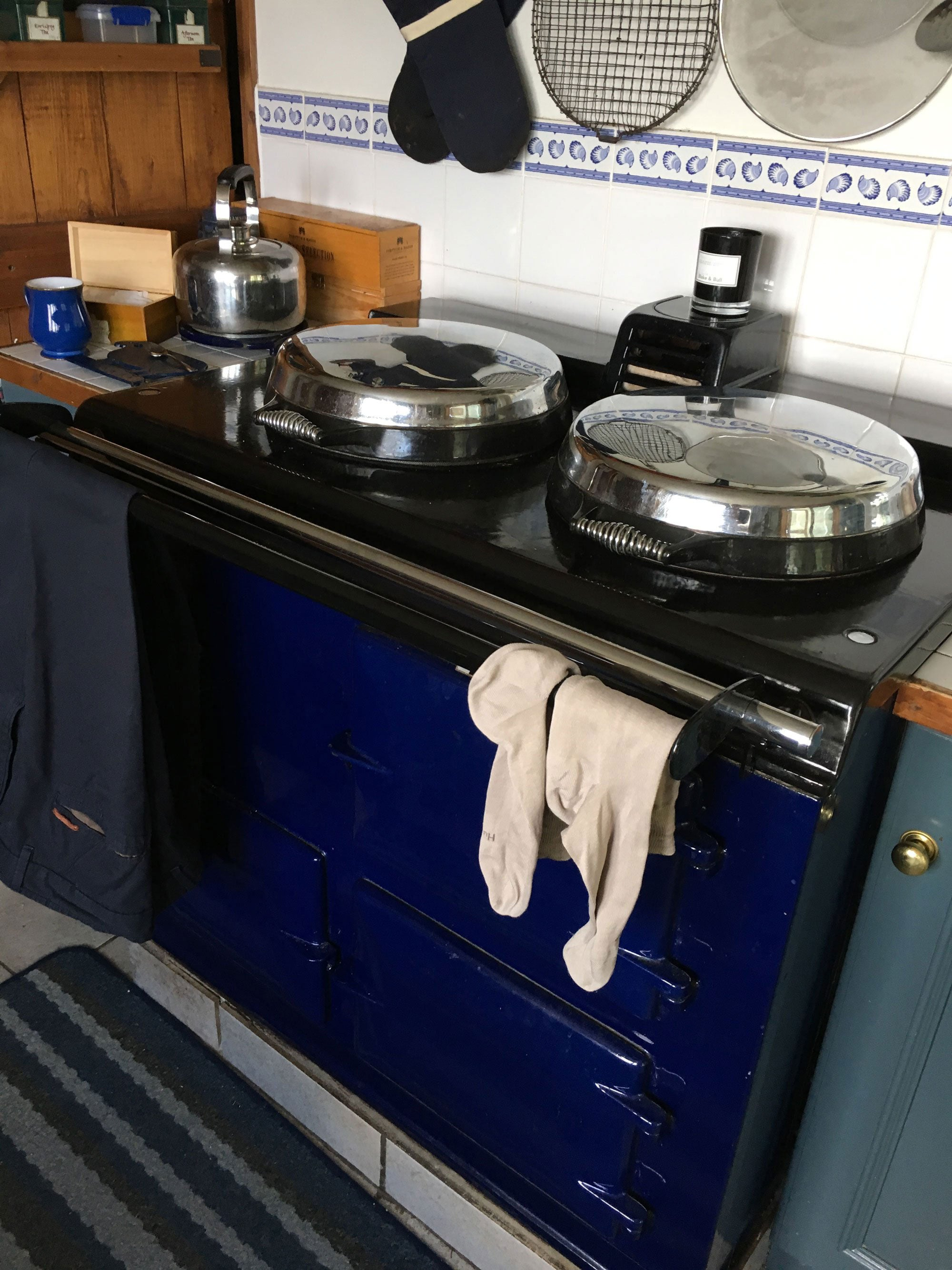 Blue Aga range cooker with drying rail
