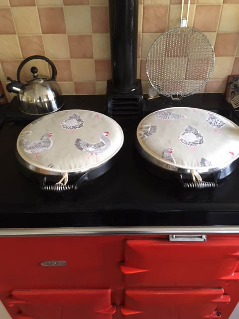 Red Aga with chicken hob covers