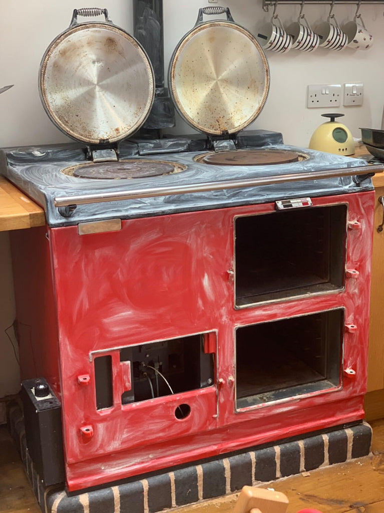 A pillar box red aga range cooker