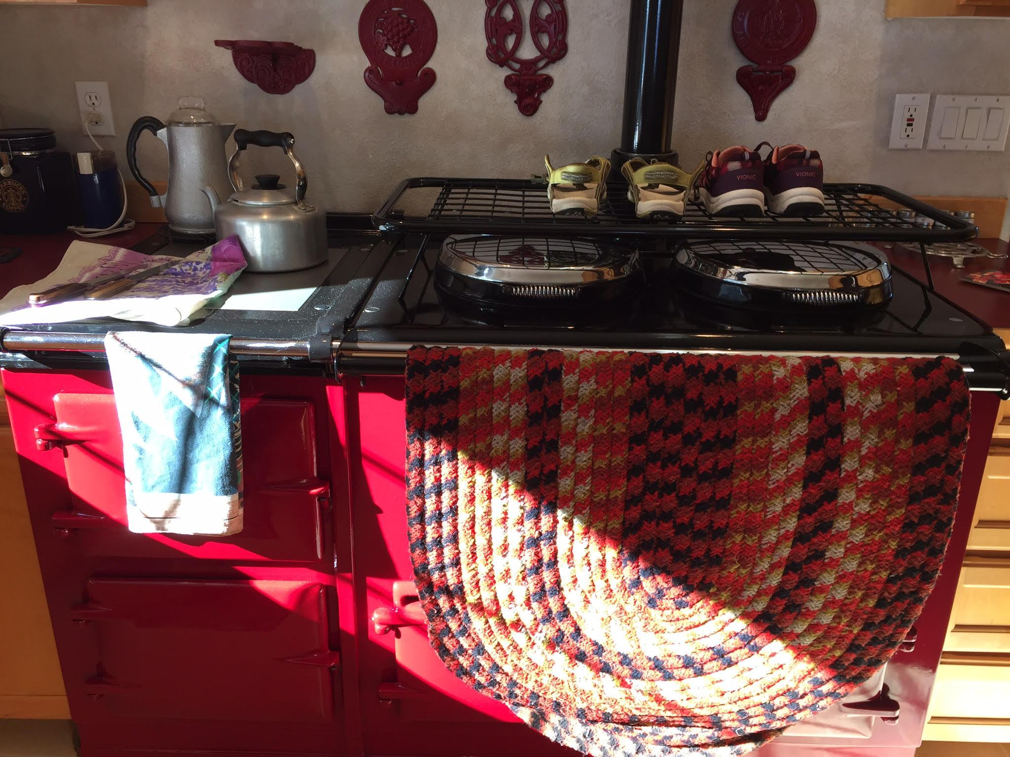 Red Aga range cooker drying a rug!