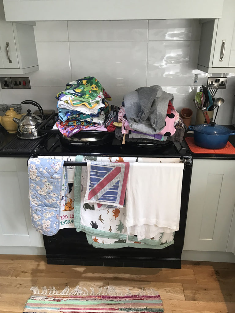 Drying rack loaded with laundry washing drying rack suitable for use on an Aga range cooker