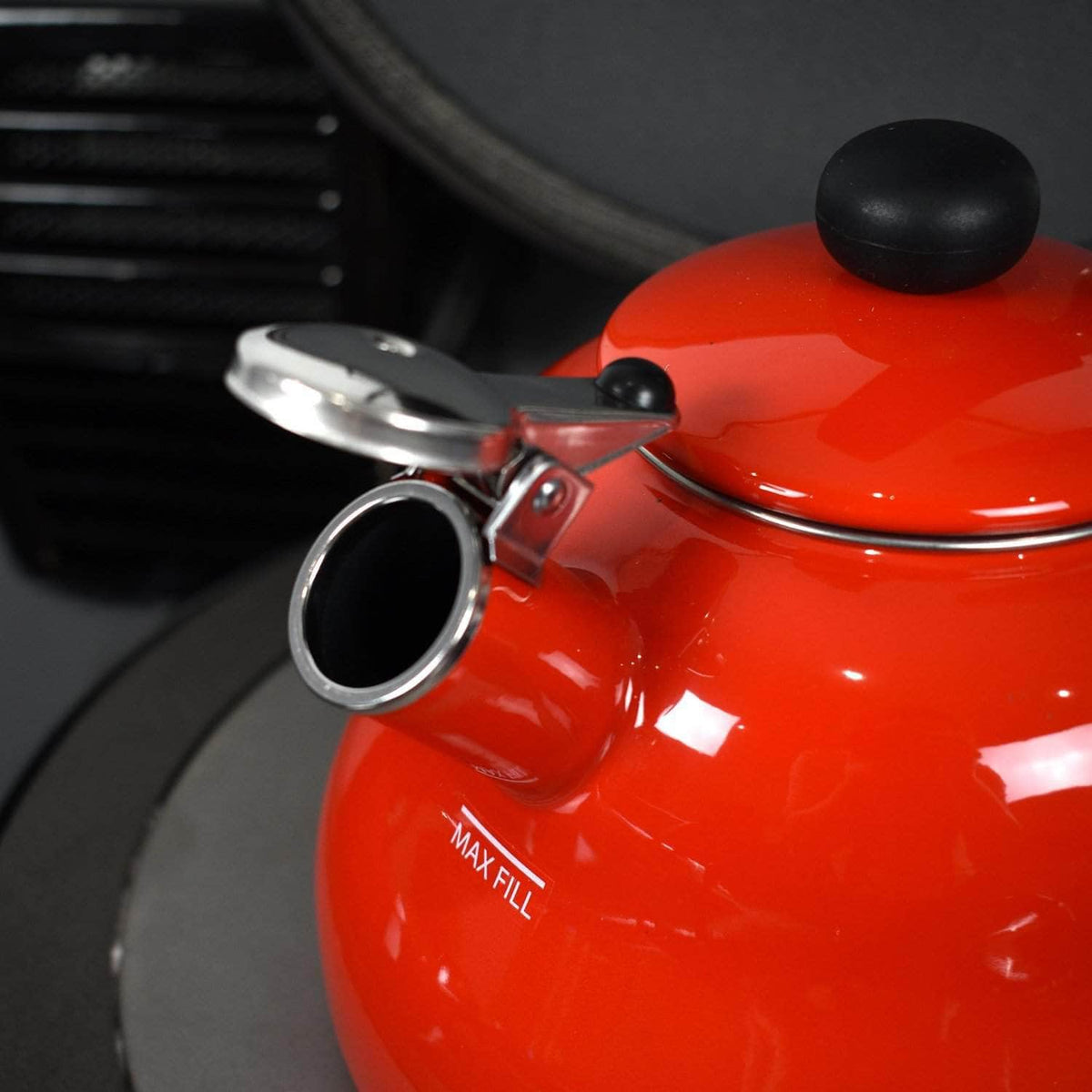 Whistling kettle in red enamel