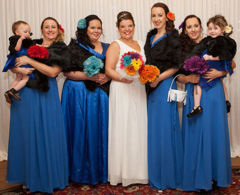 Floor length blue bridesmaids dresses and wraps