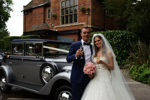 Traditional wedding car at Moxhull Hall