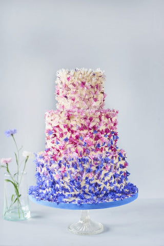 Wedding cake with edible pink and blue flowers