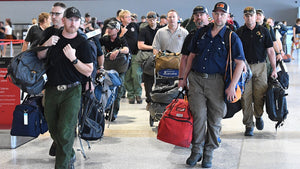US Firefighters cheered as they arrive at Sydney International Airport