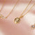 "14kt Gold ""Love Conquers All"" Diamond Pendant"
