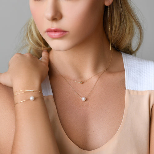One Akoya White Pearl and One Gold Ball Necklace
