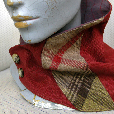 Rich Terracotta thick cotton neck wrap with a check wool tweed panel, fastenes with two buttons.