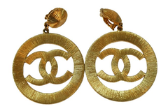 ** Chanel Vintage CC Large Gold Sunburst Earrings, Rihanna: Pour it Up **