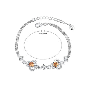 Simple and Fashion Three-leafed Clover Champagne Cubic Zircon Bracelet
