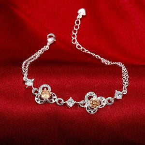 Simple and Fashion Three-leafed Clover Champagne Cubic Zircon Bracelet - Glamorousky
