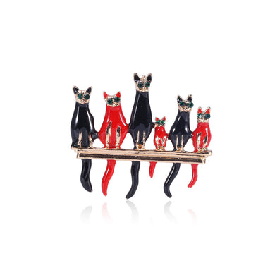 Simple and Creative Black Cat Red Cat Brooch with Green Cubic Zirconia