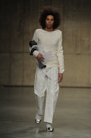 Claire Barrow Autumn/Winter 2013 Look 11 White Hand painted cotton jeans and jersey printed top with hand painted leather doll bag