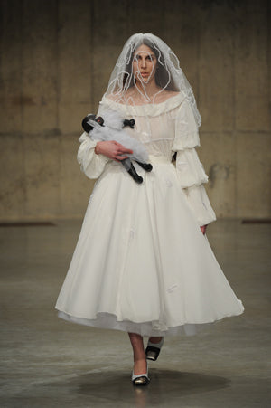 Claire Barrow Autumn/Winter 2013 Look 12 white wedding dress with hand painted leather doll bag