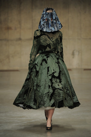 Claire Barrow Autumn/Winter 2013 Look 5 Velvet devore print green dress and hand painted marble leather lampshade hat