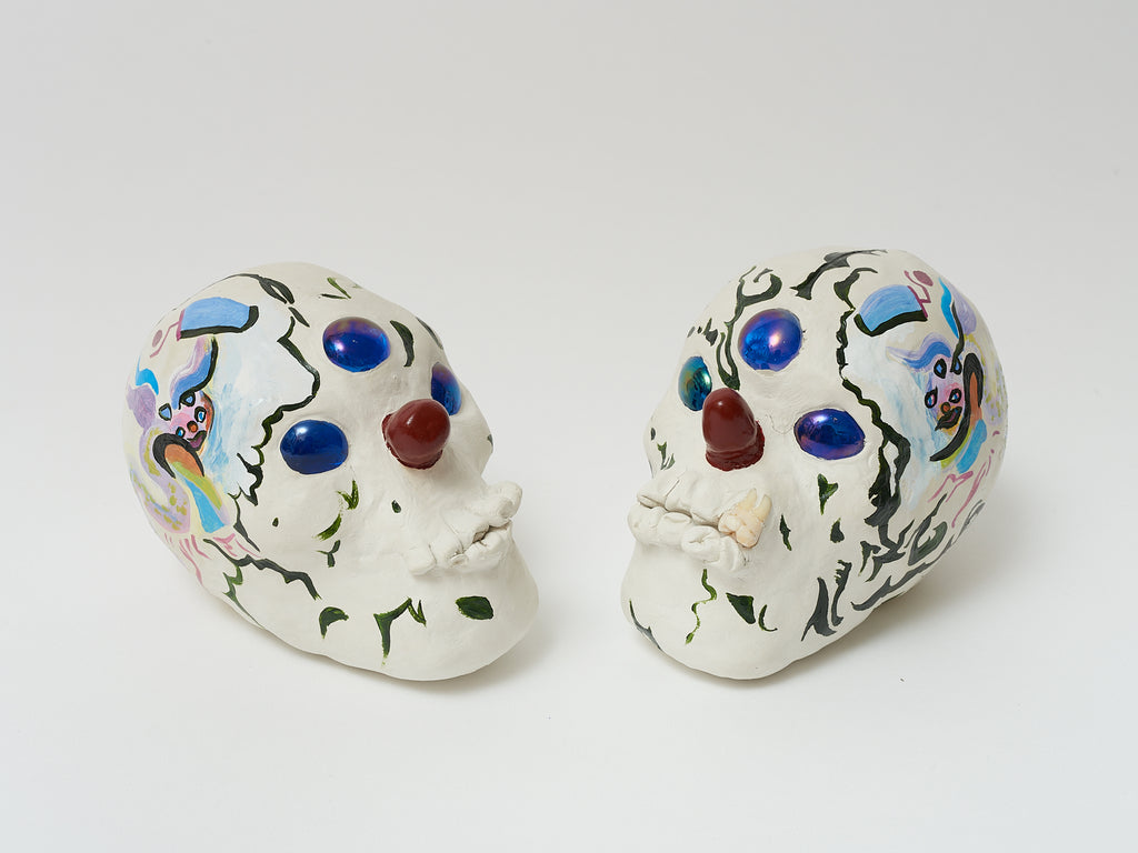 Skulls 1 & 2, 14cm x 14cm x 10cm , clay and mixed media from 'Pig Latin Library'