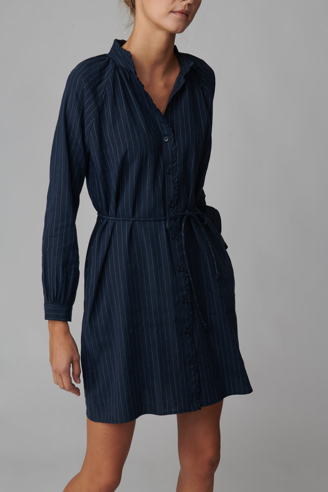 Emeline is 5'11 and wears a size S in navy pinstripe