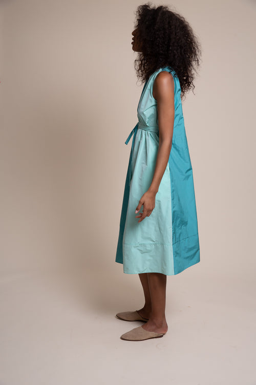 Made from sustainable Newlife recycled polyester taffeta, the Vestry dress has a split personality - wear it loose and easy or create a little drama by belting it.