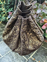 Serpent print hand bag