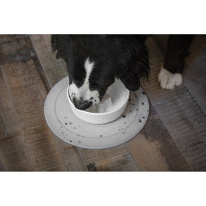 dog drinking from a be one breed  cool bowl on an absorbent stone placemat