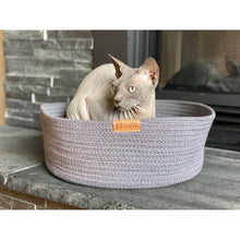 Load image into Gallery viewer, Cat using grey be one breed cat cuddler in front of fireplace va0