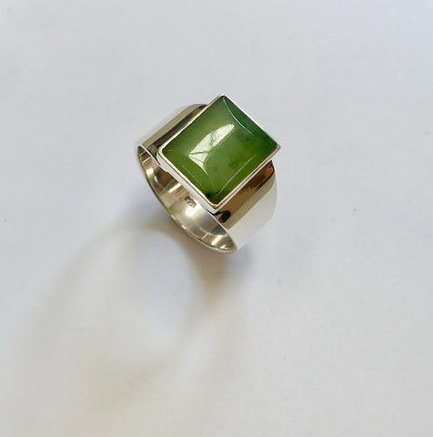 pounamu signet ring (dark inclusions)