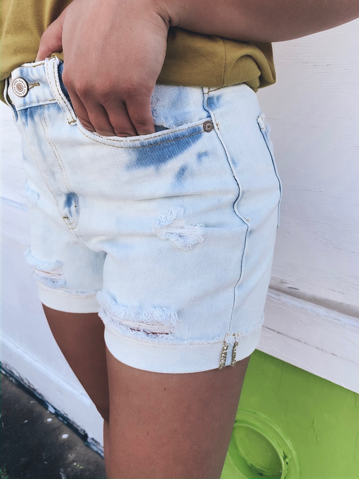 On Tour High Rise Distressed Denim Shorts