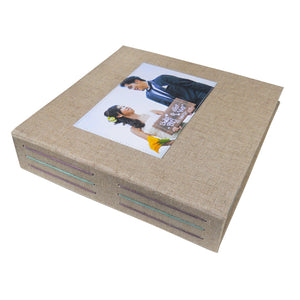 linen photo album with wedding photo of couple on front