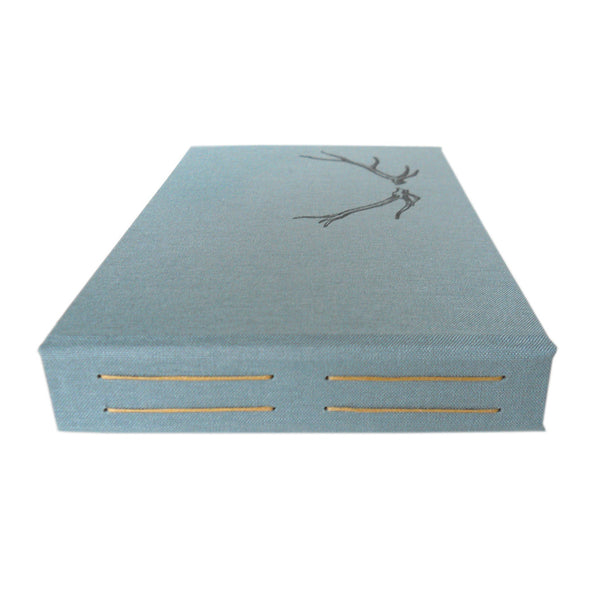 slate blue 4x6 photo album with anter image