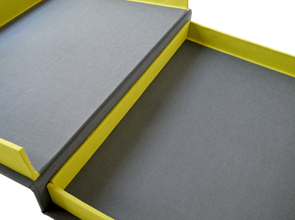 detail image of gray and chartreuse clamshell box