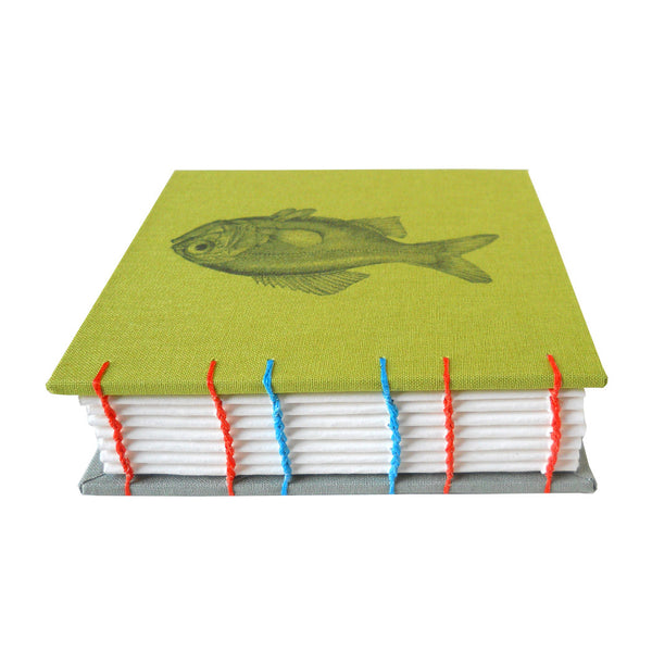 lime green coptic bound book with fish image
