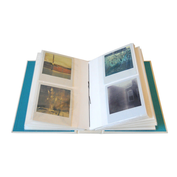 polaroid photos in slip in style photo album