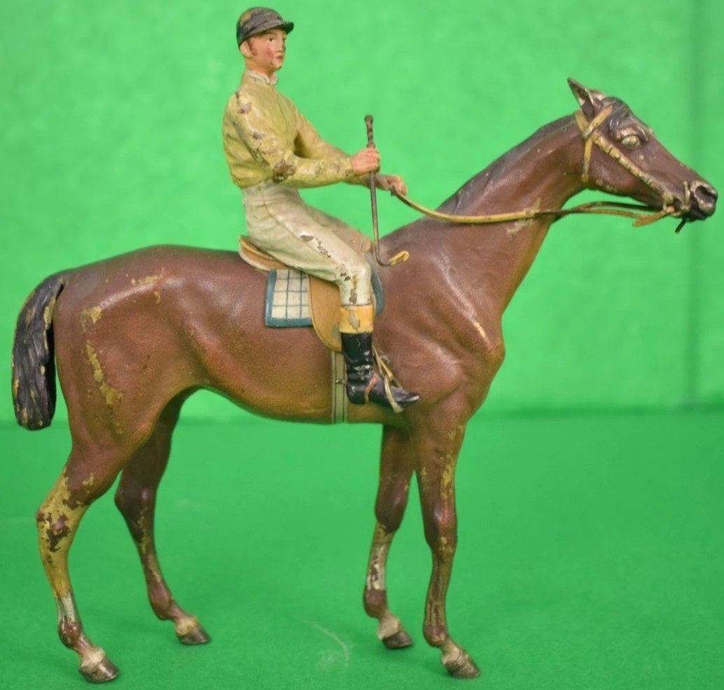 Austrian Bronze Jockey Up on Racehorse