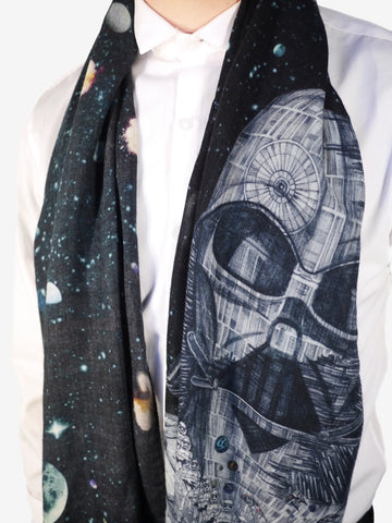 The Vader Long Wool Scarf features a hand-drawn illustration of Darth Vader morphing into the Death Star.