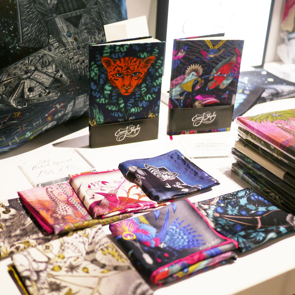 Left: Silk pocket squares and notebooks are always some of our bestselling pieces. Right: The colourful setting of the festival at 180 The Strand
