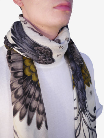 Left and right: This scarf can be worn draped around the shoulders or tied around the neck - a masculine look for any man. Featuring vibrant, fantastical birds in flight, this scarf is set upon a stylish colour of gold and yellow.