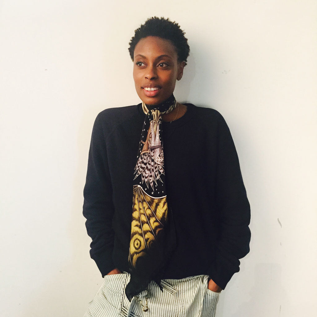 Donna Wallace, accessories editor for Elle magazine, wearing the Drakon silk skinny scarf in black.