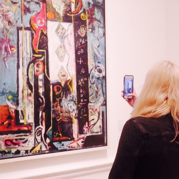 Left and right: Emma admiring paintings by artist Jackson Pollock (Left - Male and Female, 1942-43. Right - Blue Poles, 1952)