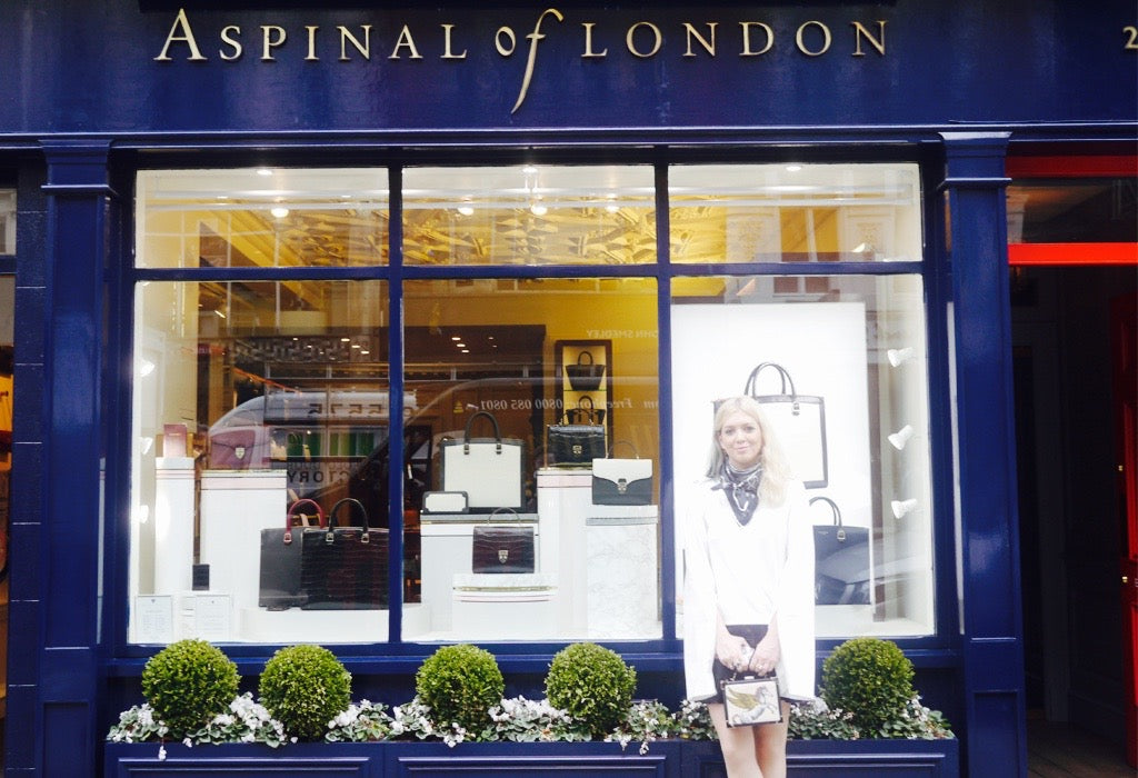 Emma posing outside the Aspinal of London flagship store in Mayfair.