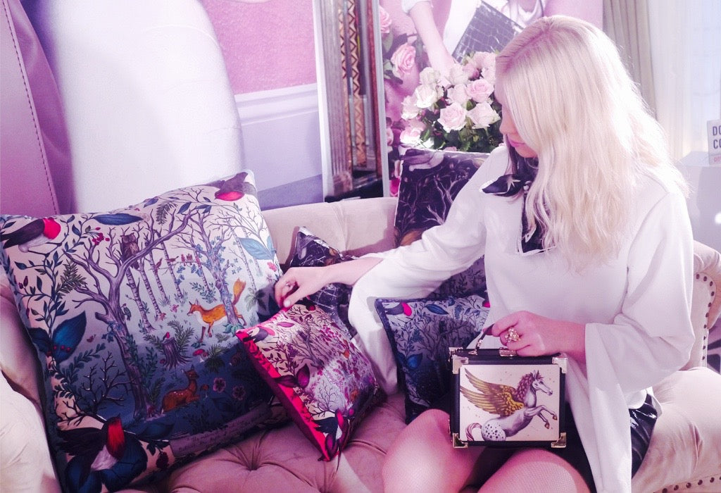 Emma arranging the cushions that decorated the stage, which she designed in collaboration with Michelle Dockery.
