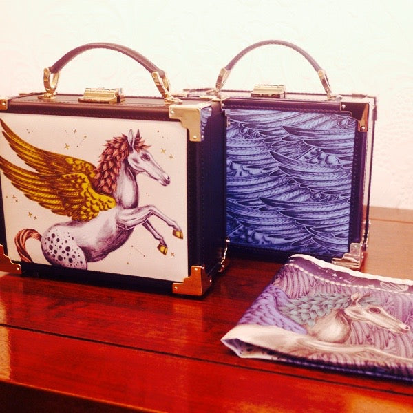 Left and right: Clutches and scarves from the AW16 Aspinal x EJS Pegasus collection.