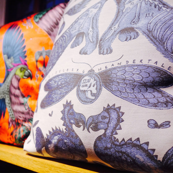 Left and right: Detailed shots showing the intricate detail of the new Extinct and Constellations cushions.