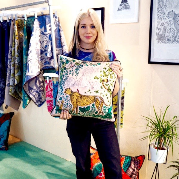Left: Emma with the Cheetah silk cushion on the stand at LuxuryMade. Right: Emma with @interiorshunter.